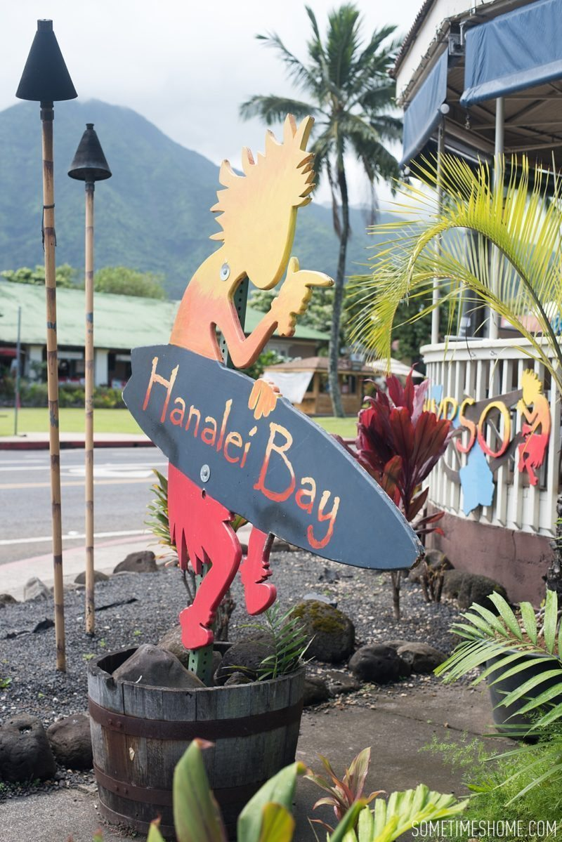 What to do and see in north Kauai, Hawaii, Hanalei Bay Kokopelli sign photo on Sometimes Home travel blog by Mikkel Paige.