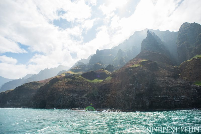 """Travel tips on Hawaii, south and east ends of Kauai island by Mikkel Paige. Photos of the Napali Coast """"Cathedrals"""" from a boat tour."""