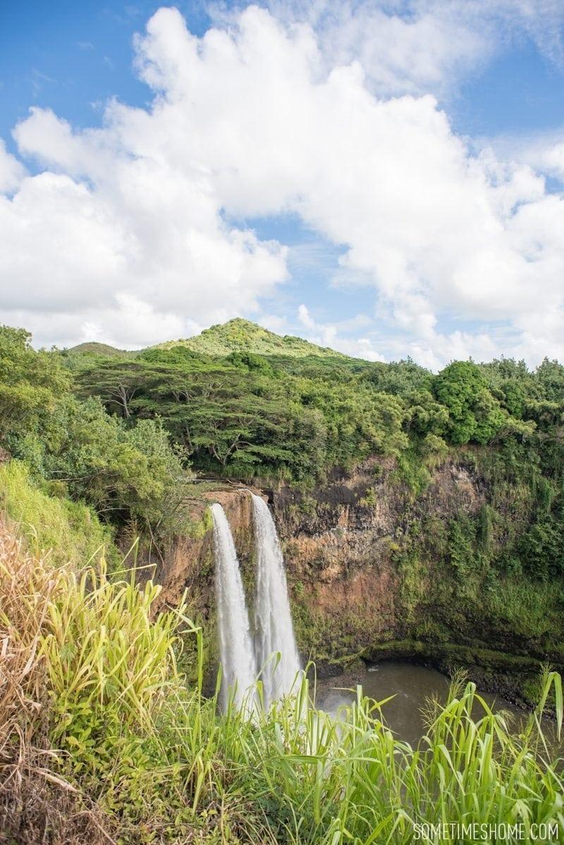 Wailua Falls photos in Kauai, Hawaii on travel blog Sometimes Home. Images by Mikkel Paige.
