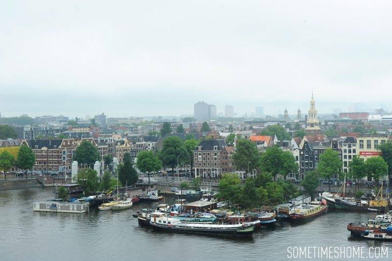 Things to do in Amsterdam besides smoking pot by travel blog Sometimes Home. View from the public library on a rainy day.