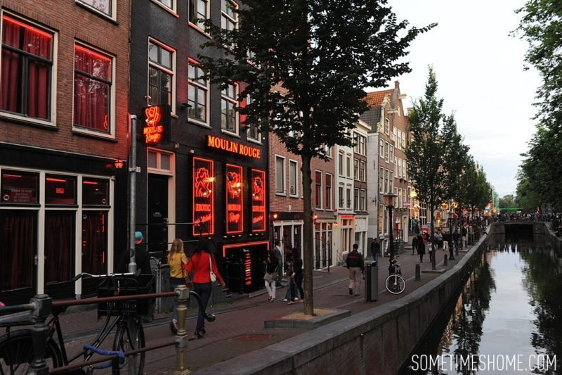 Things to do in Amsterdam besides smoking pot by travel blog Sometimes Home. Photos of the streets of the city in the red light district.
