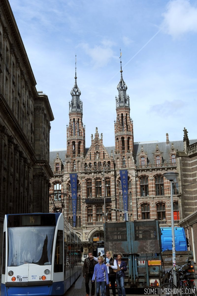 Things to do in Amsterdam besides smoking pot by travel blog Sometimes Home. Photos of Dam Square area with Magna Plaza shopping center.