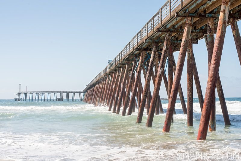 Photo spots at Rosarito beach in Baja California, Mexico, by travel blog Sometimes Home, including the rusting ocean dock.