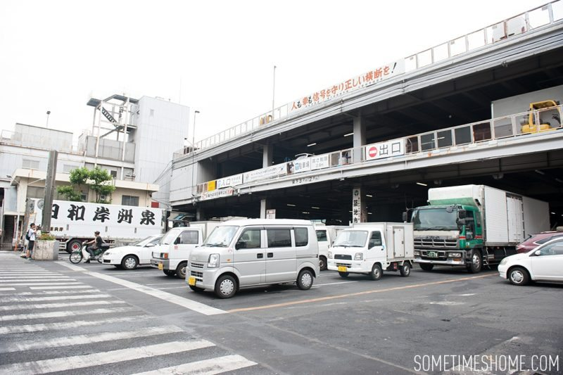 Experience and photos at Tsukiji Fish Market in Tokyo, Japan by Sometimes Home Travel Blog. Picture of trucks lined up to do business.