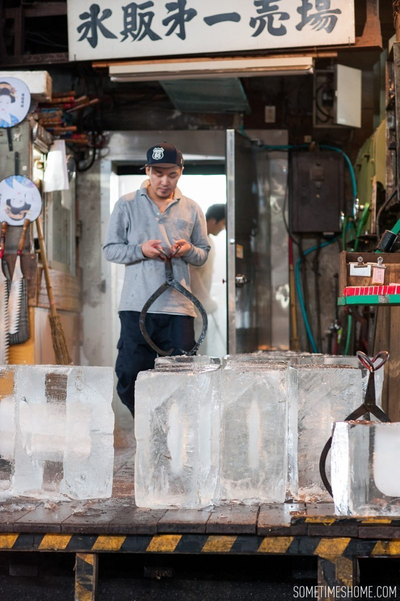 Experience and photos at Tsukiji Fish Market in Tokyo, Japan by Sometimes Home Travel Blog. Picture of a vendor moving huge blocks of ice.