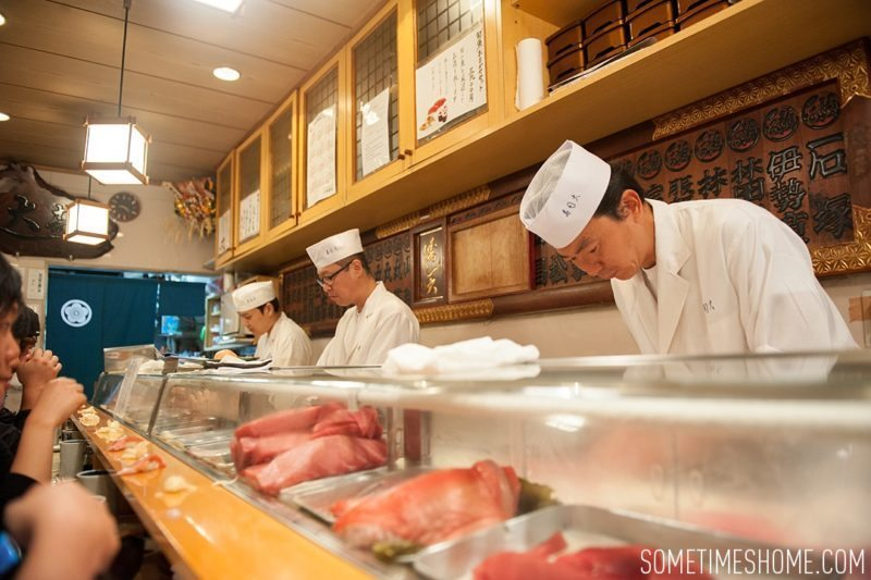 Sushi Dai Restaurant at Tsukiji Fish Market in Tokyo Japan. Photos on Sometimes Home travel blog with the counter service inside a small restaurant.