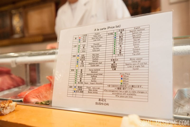 Sushi Dai Restaurant at Tsukiji Fish Market in Tokyo Japan. Photos on Sometimes Home travel blog with the menu of options in English.