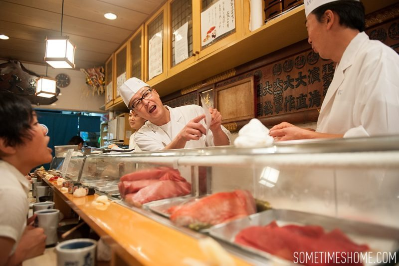 Sushi Dai Restaurant at Tsukiji Fish Market in Tokyo Japan. Photos on Sometimes Home travel blog with a picture of the chefs!