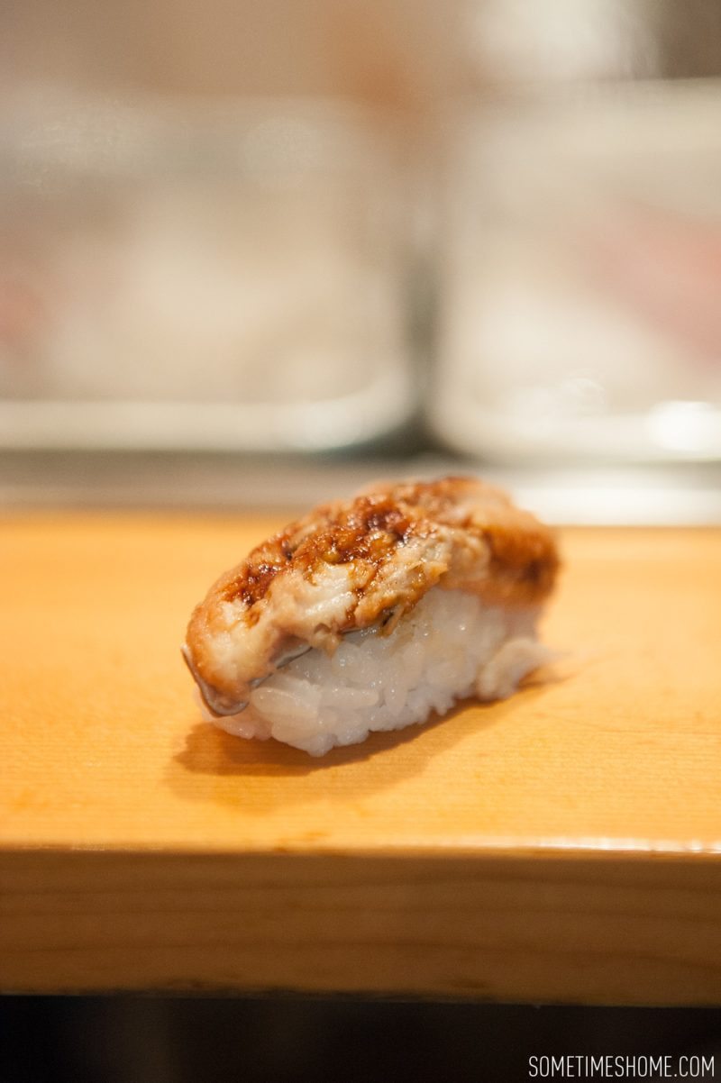 Sushi Dai Restaurant at Tsukiji Fish Market in Tokyo Japan. Photos on Sometimes Home travel blog with a picture of sea eel.