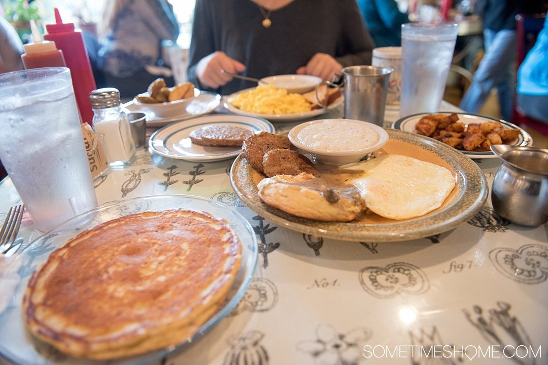 What to do on a rainy day in Boone, NC. Photos and activities on Sometimes Home travel blog. Picture of a hearty breakfast from Melanie's Food Fantasy, including grits and pancakes.