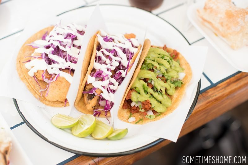 Travel photos and ideas in Tijauna, Mexico with hipster spot Telefonica Gastropark food truck hotspot on Sometimes Home blog. Tacos image with various vegetarian options.