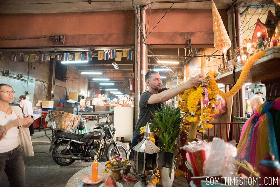 Fascinating Bangkok Place to Visit: Bangrok Tour, East Meets West by Sometimes Home travel blog. Photo of a flower offering to the gods.
