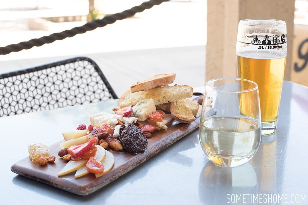 My 12 Favorite Spots Around San Diego California. Photos including Balboa Park restaurant Panama 66 cheese plate, beer and wine.