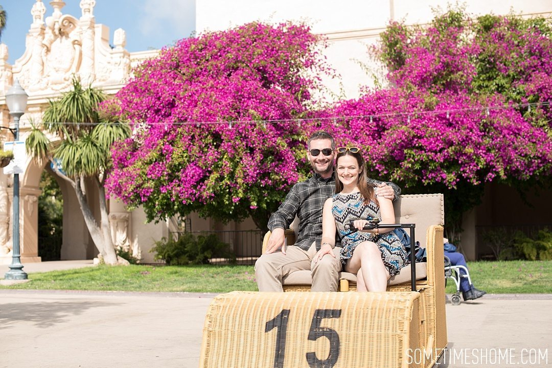 My 12 Favorite Spots Around San Diego California. Photograph of pink bougainvillea and electric wicker carts at Balboa Park.