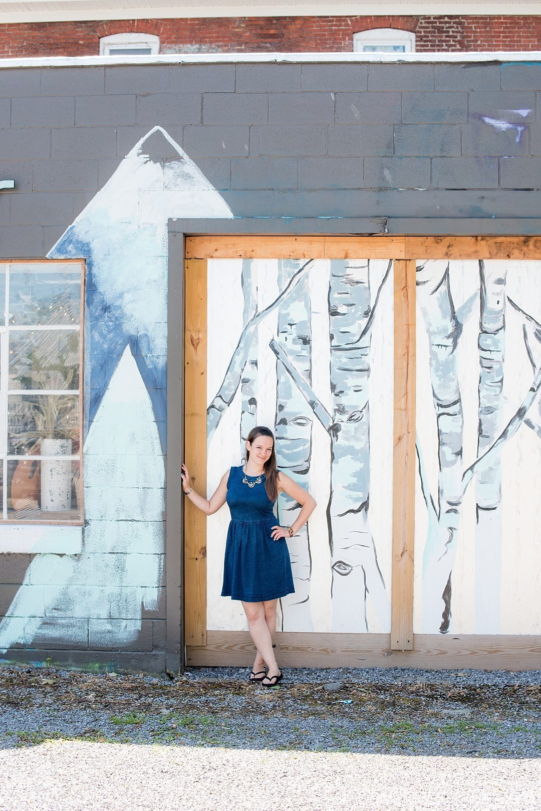 Why a Trip to Buffalo Had Me in Disbelief on Sometimes Home travel blog. Photo of Muse Jar art store birch trees mural in East Aurora, New York.