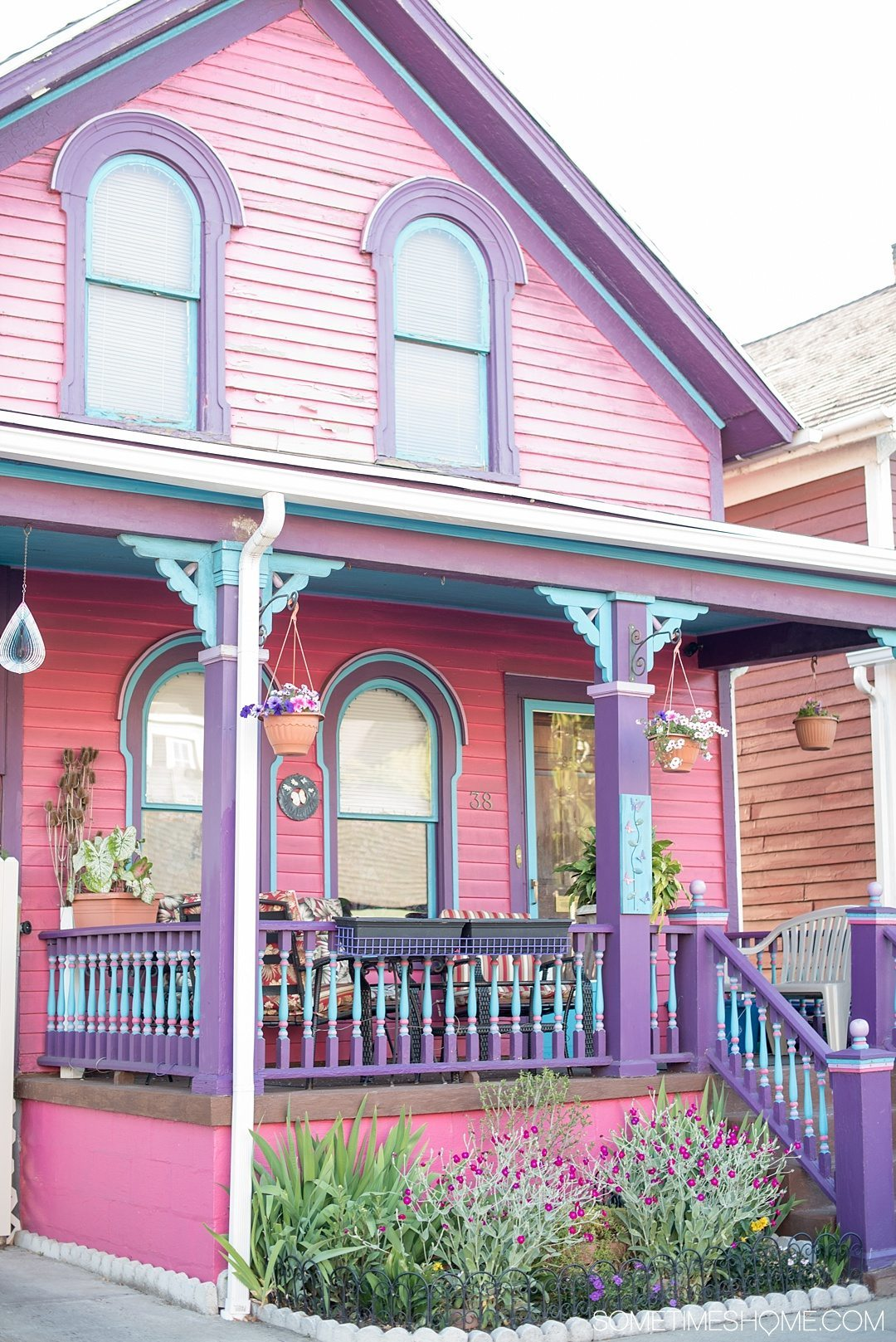 Why a Trip to Buffalo Had Me in Disbelief on Sometimes Home travel blog. Photo of a pink, blue and purple house in the city's downtown area of Allentown.