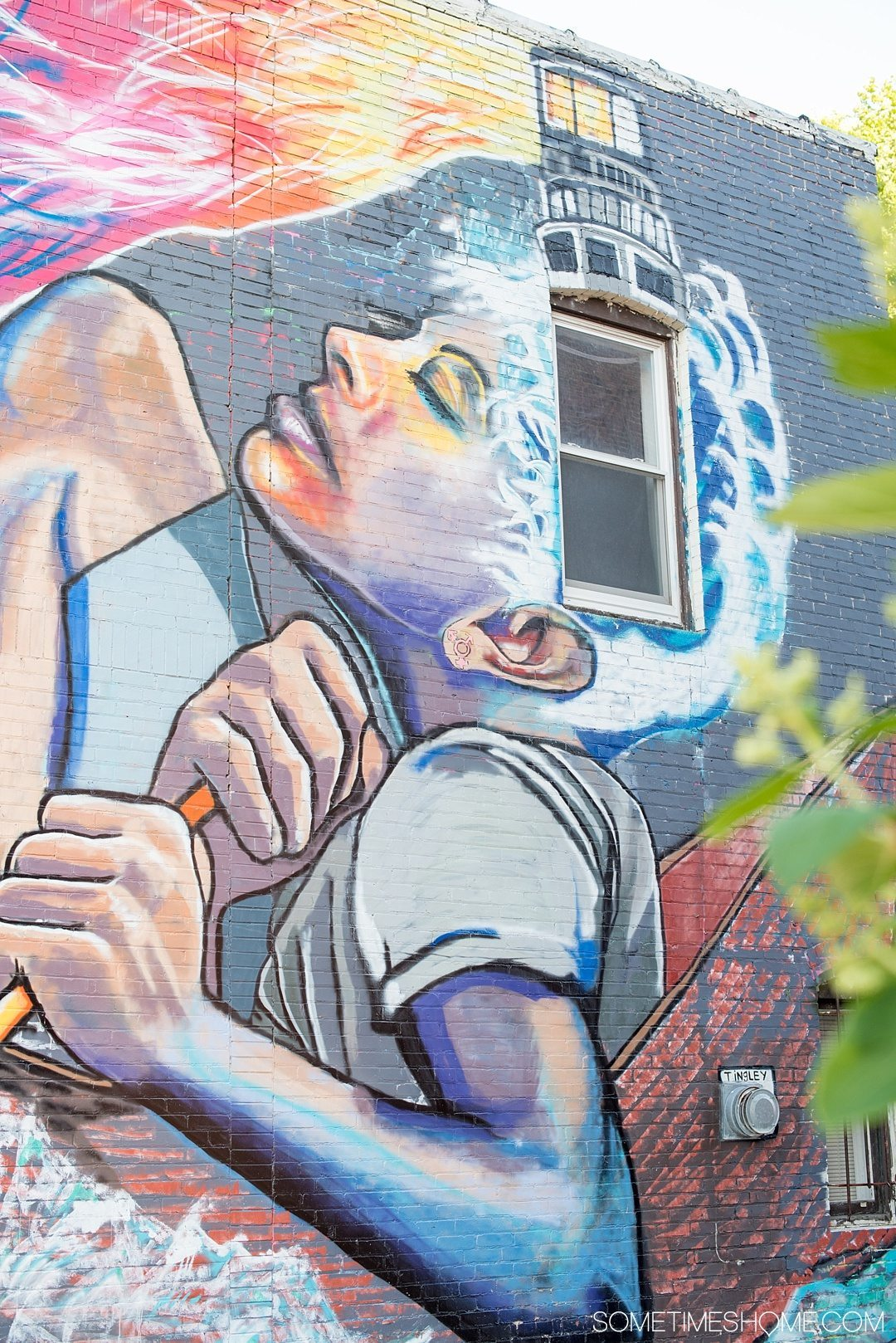 Why a Trip to Buffalo Had Me in Disbelief on Sometimes Home travel blog. Photo of colorful mural in the city's downtown area of Allentown.