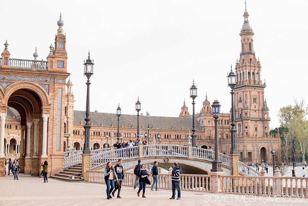 You Haven't Seen Seville Until You've Visited These 3 Sites, by Sometimes Home travel blog. Photo of Plaza de Espana's lights and bridges.