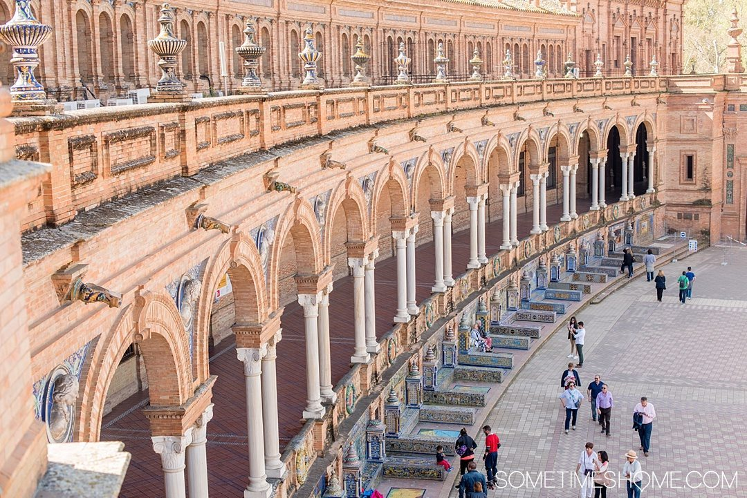 You Haven't Seen Seville Until You've Visited These 3 Sites, by Sometimes Home travel blog. Photo of Plaza de Espana's colorful colonnade and arches.