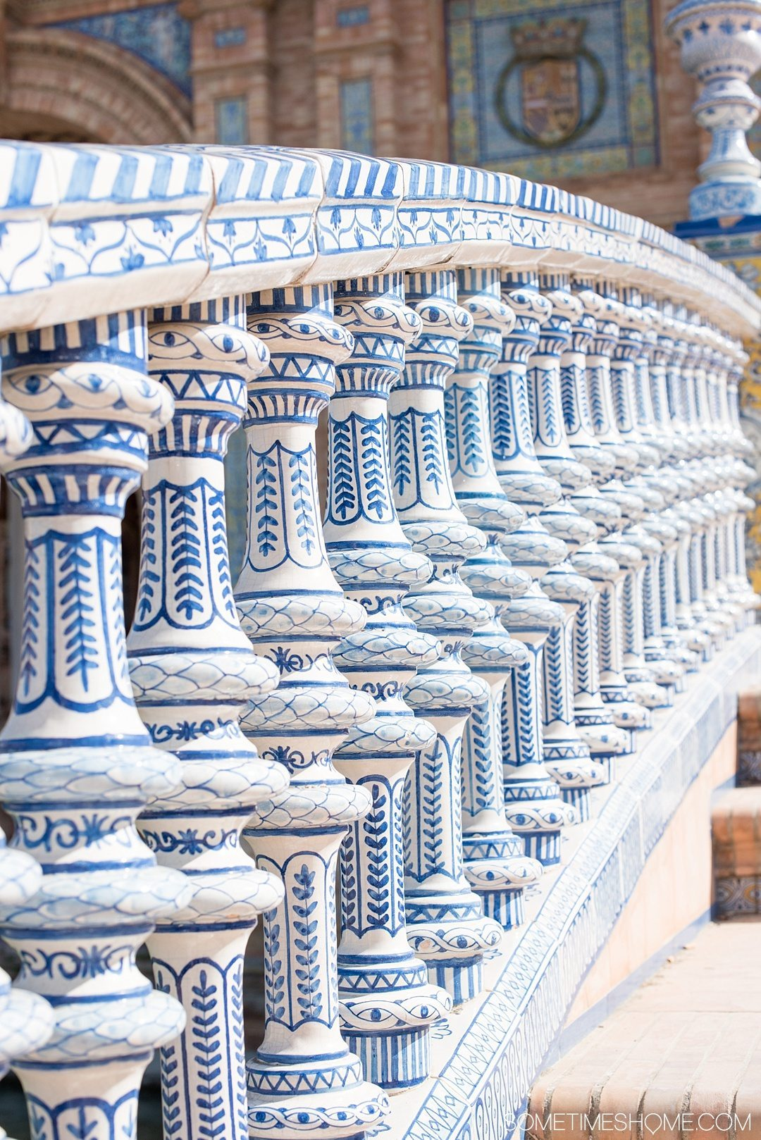 You Haven't Seen Seville Until You've Visited These 3 Sites, by Sometimes Home travel blog. Photo of Plaza de Espana's colorful handpainted blue and white ceramic railings.
