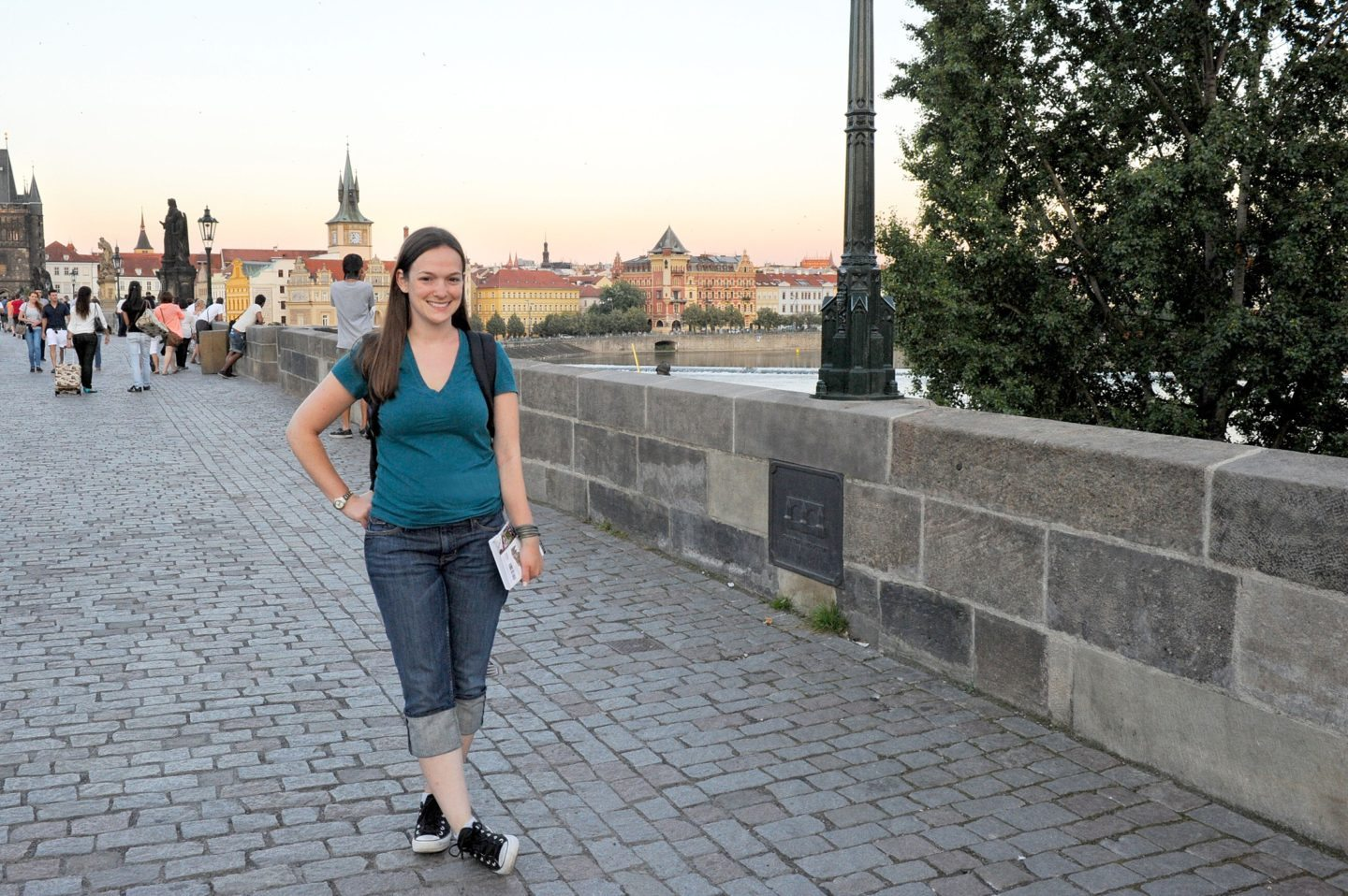 Why I Started Traveling Solo and You Should Too by Sometimes Home travel blog. Photo in Prague on the famous Charles Bridge.