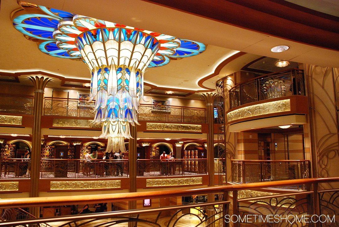 Disney Cruise Line is For Adults Too. Sometimes Home travel blog insight and info into DCL's adult only activities and areas. Photo of a ship atrium with art deco style decor.