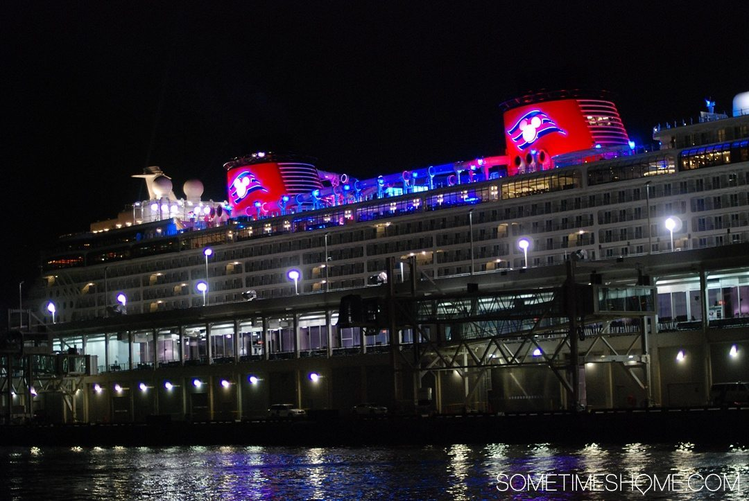 Disney Cruise Line is For Adults Too. Sometimes Home travel blog insight and info into DCL's adult only activities and areas. Photo of ship docked in New York at night.
