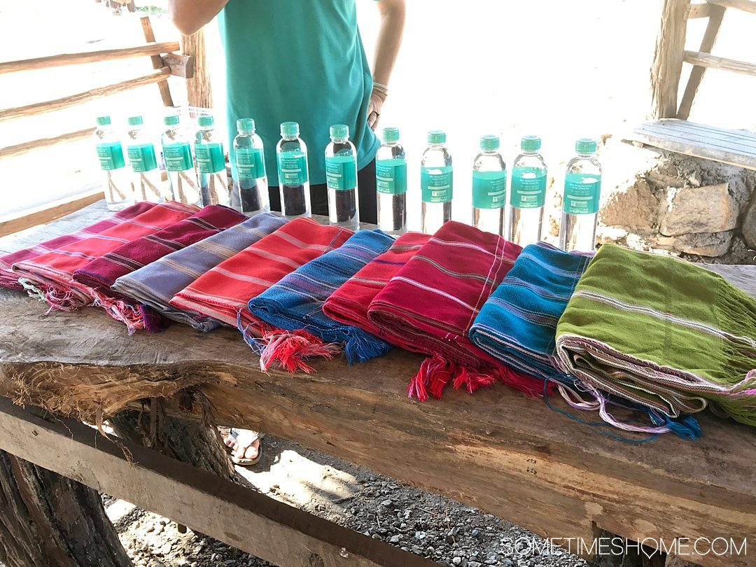 Vital FAQs Answered About Patara Elephant Farm in Chiang Mai. Information by Sometimes Home travel blog. A photo of their custom branded water bottles and cloth shirts and pants worn on the elephants.
