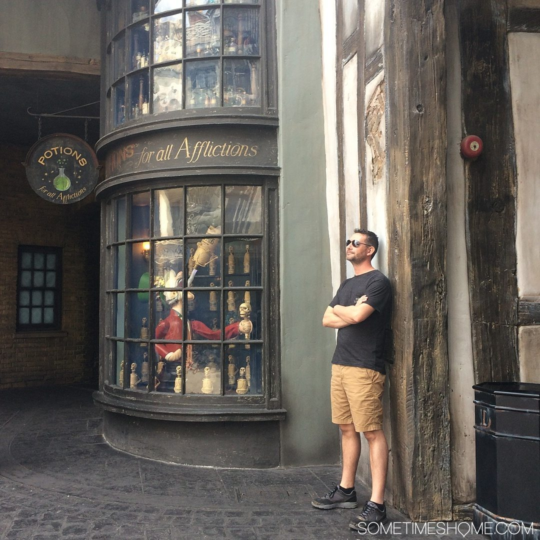5 Mistakes to Avoid at the Wizarding World of Harry Potter in Orlando, Florida by Sometimes Home travel blog. Photo from the potions window in Diagon Alley.
