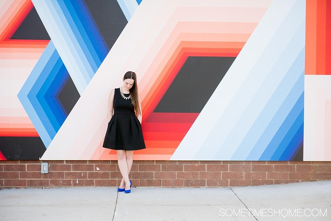 10 Best Downtown Raleigh Photography Spots on Sometimes Home travel blog. Photo of a geometric red, black and blue mural wall.