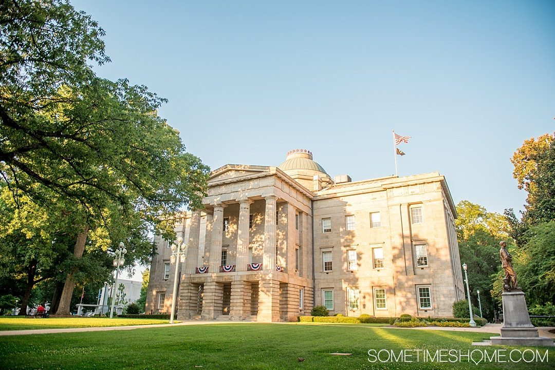 10 Best Downtown Raleigh Photography Spots on Sometimes Home travel blog. Photo of the Capital Building during golden hour.