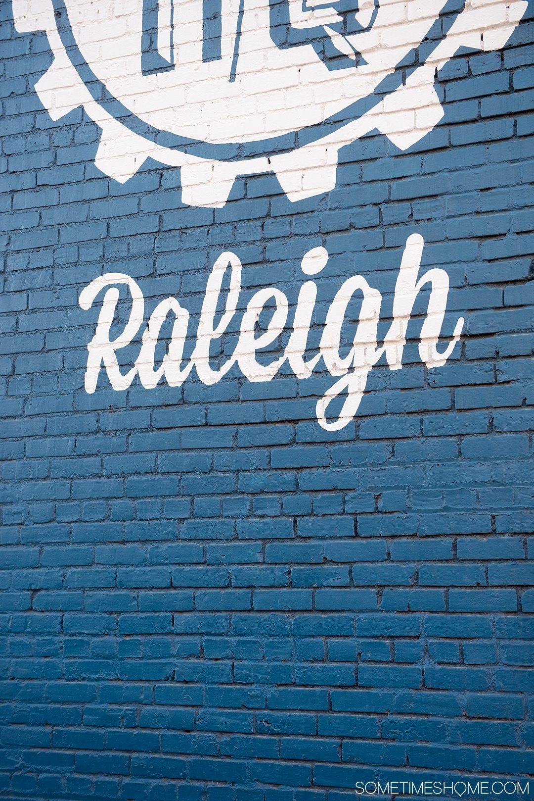 10 Best Downtown Raleigh Photography Spots on Sometimes Home travel blog. Photo of HQ Raleigh's blue mural wall.