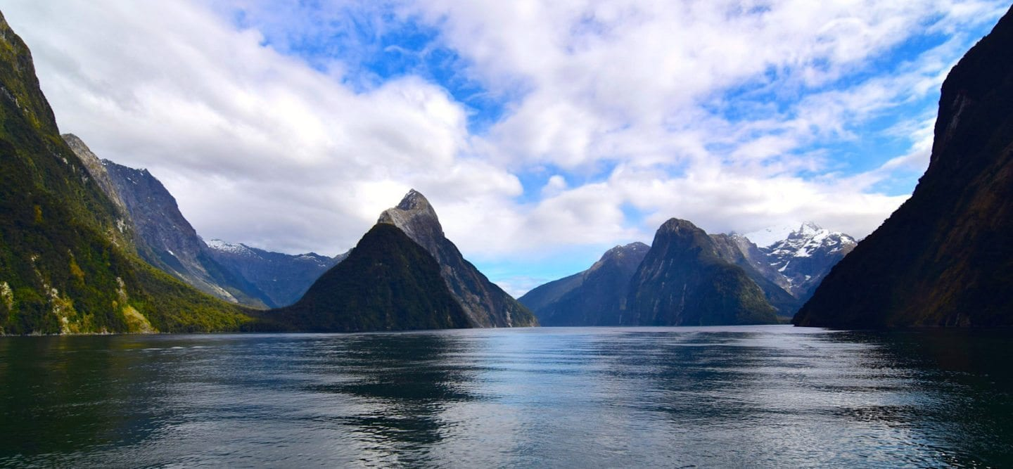 Fantastic Fall Destination Ideas Around the World on Sometimes Home travel blog. Picture of Milford Sound, New Zealand by Positive Impact Podcast.