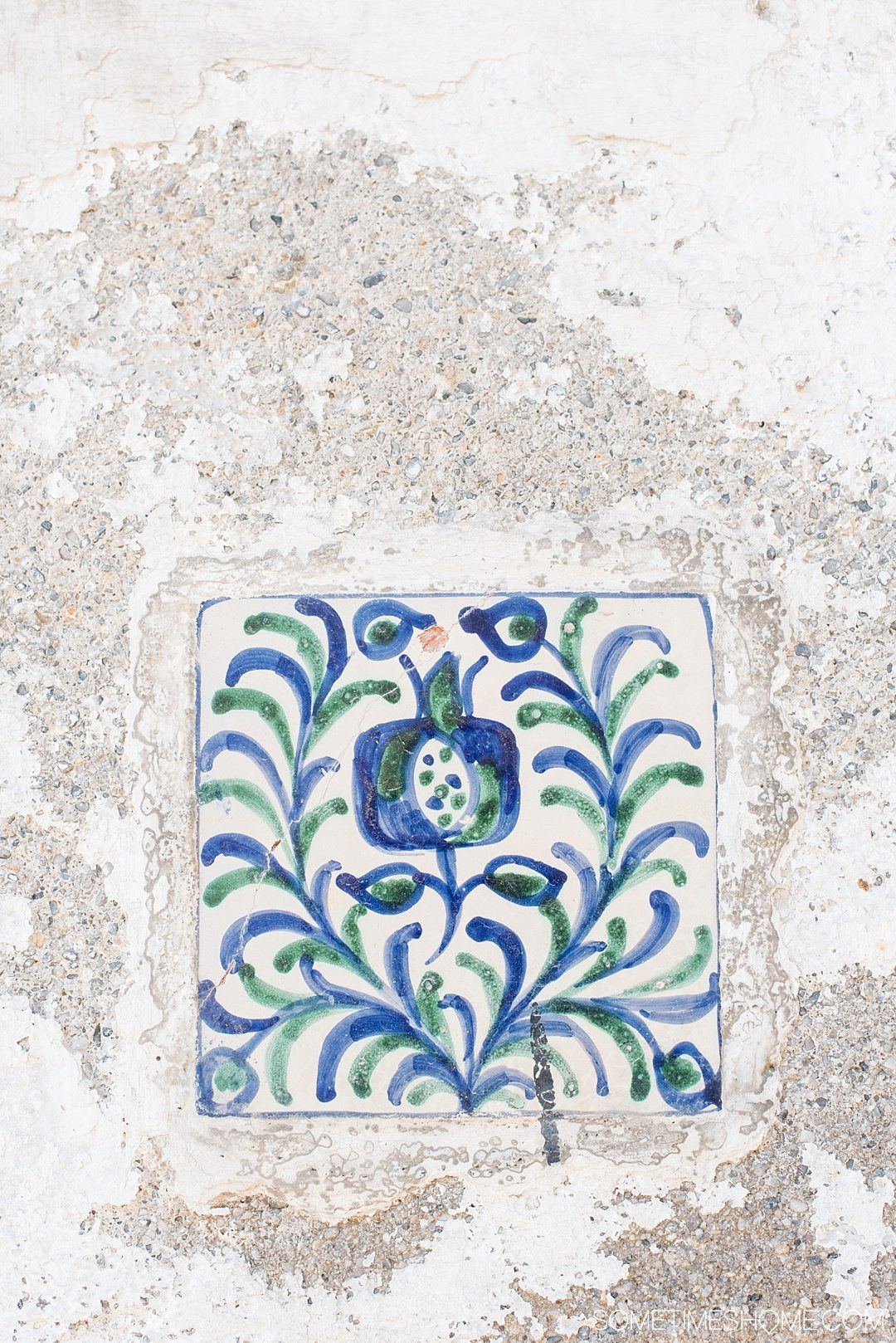 One Perfect Day in Granada Spain. Photos and itinerary on Sometimes Home travel blog. Picture of pomegranate design on hand painted tile.