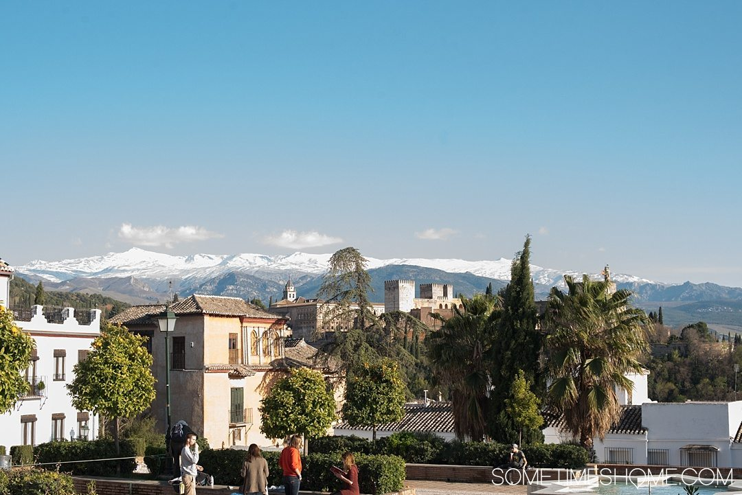 One Perfect Day in Granada Spain. Photos and itinerary on Sometimes Home travel blog. Picture of the snow capped mountain view from Placeta Cristo Azucenas.