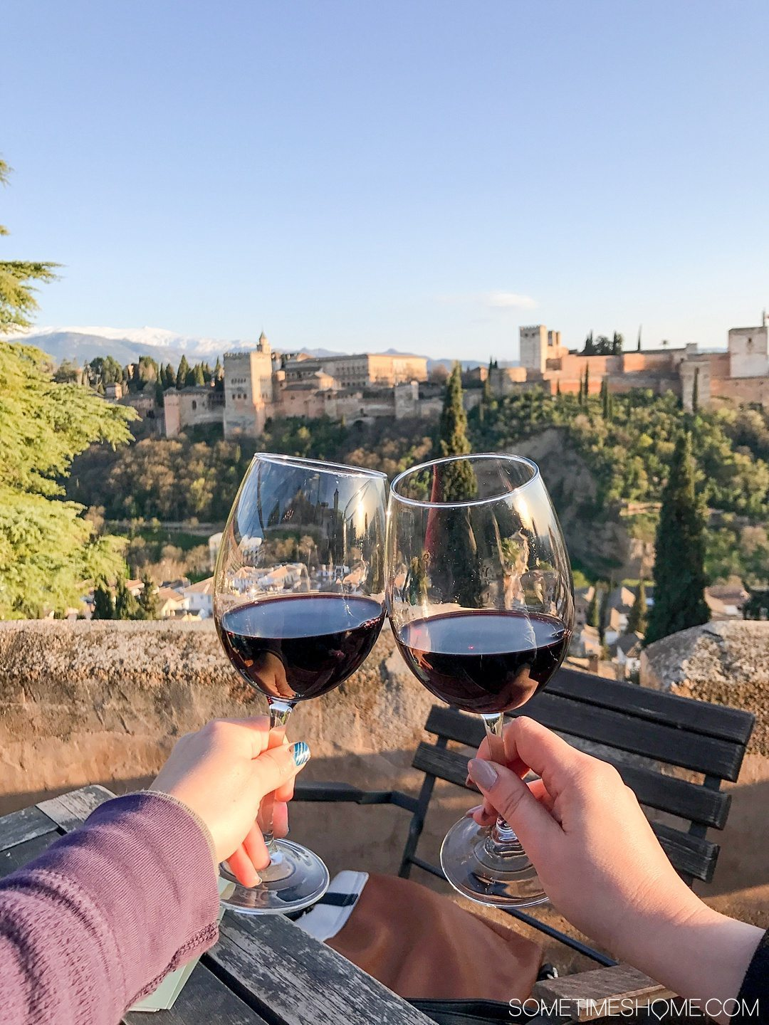 One Perfect Day in Granada Spain. Photos and itinerary on Sometimes Home travel blog. Picture of the view of the Alhambra from El Huerto de Juan Ranas.