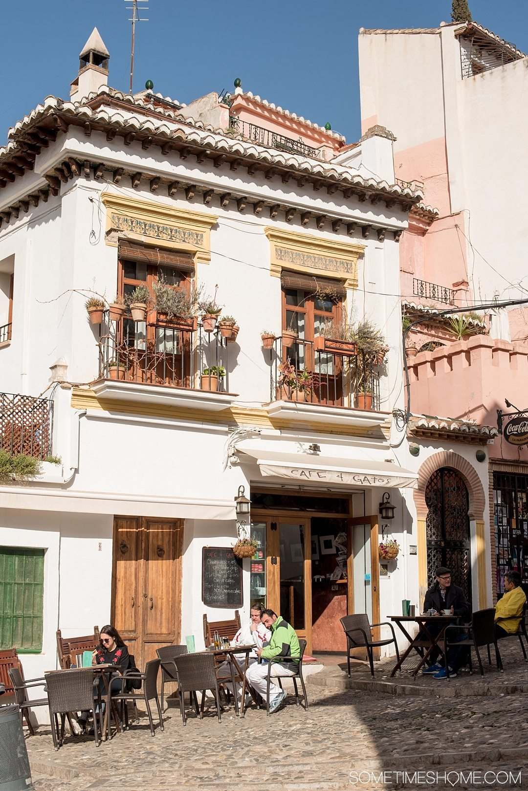 One Perfect Day in Granada Spain. Photos and itinerary on Sometimes Home travel blog. Picture of Cafe Gatos, where you can see the Alhambra.