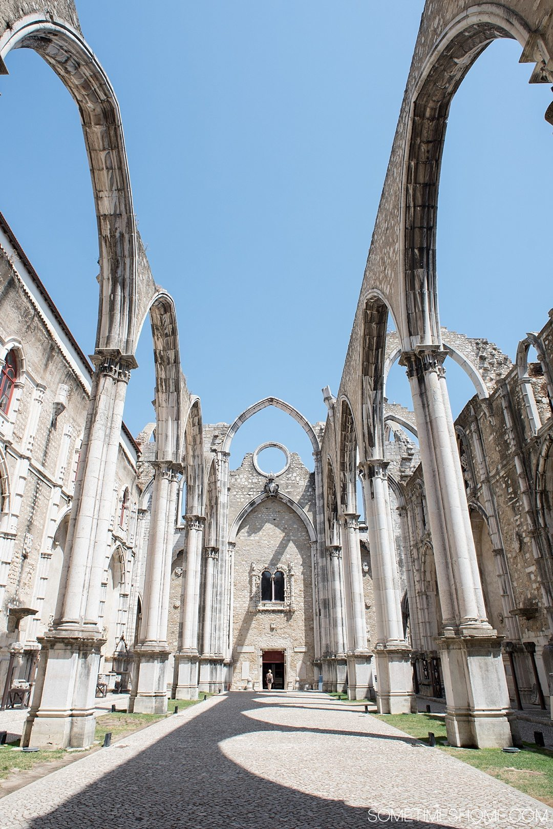 Why Lisbon is the Best City in Europe on Sometimes Home travel blog. Photo of Carmo Convent church ruins.