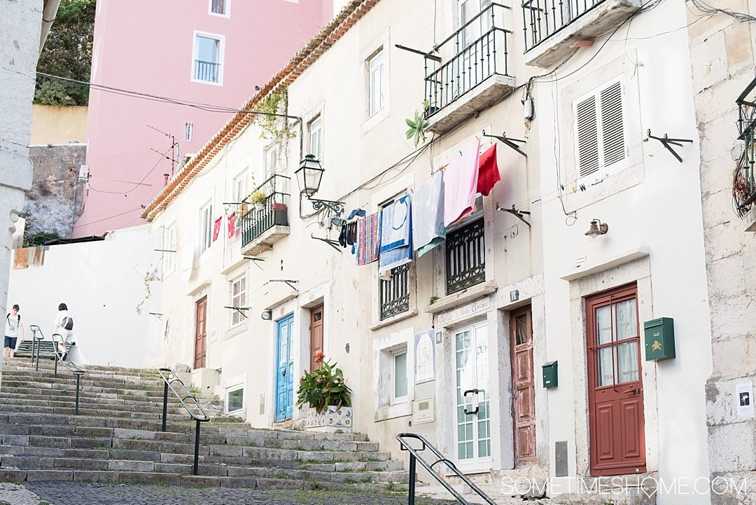 Why Lisbon is the Best City in Europe on Sometimes Home travel blog. Photo of a typical staircase alley in the city.