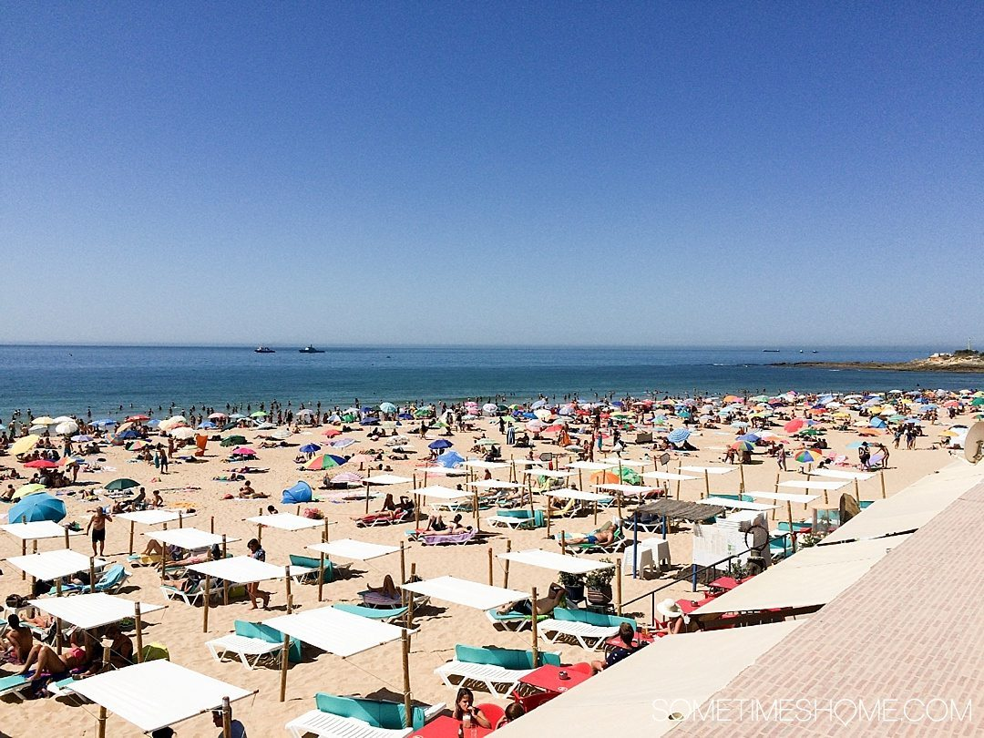 Why Lisbon is the Best City in Europe on Sometimes Home travel blog. Photo of Cascais Beach.