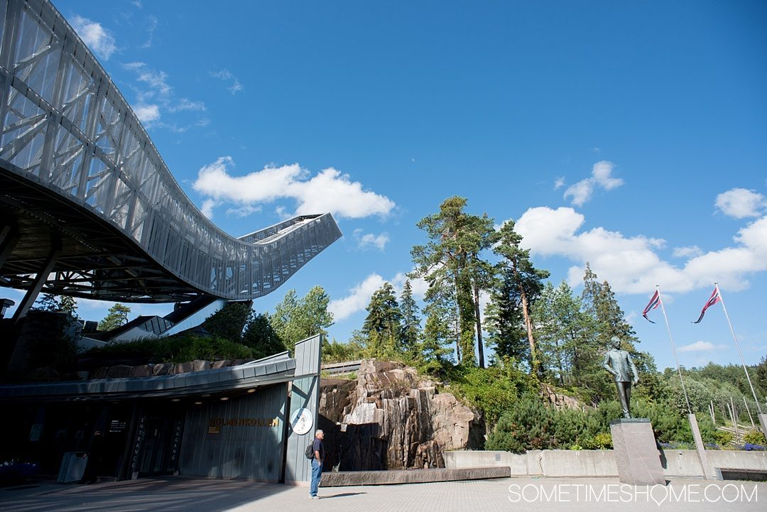 10 Not-to-Miss Sites in Oslo Norway by Sometimes Home travel blog. View of Holmenkollen ski jump during summer.