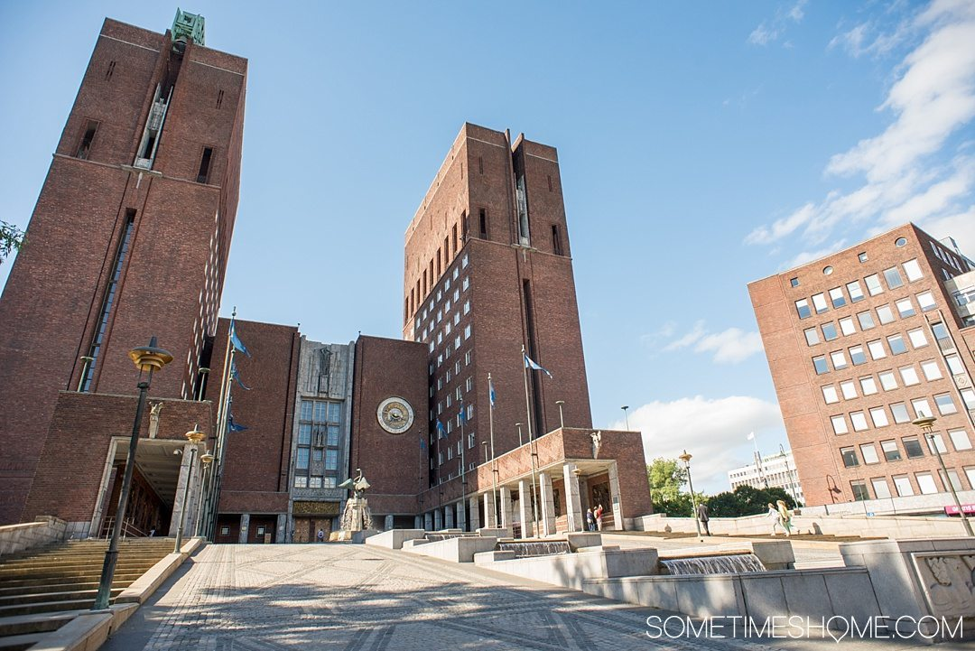 10 Not-to-Miss Sites in Oslo Norway by Sometimes Home travel blog. Photo of the brick exterior of Oslo Radhus, City Hall.