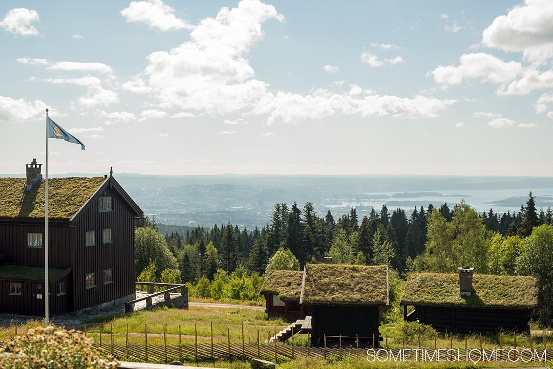 10 Not-to-Miss Sites in Oslo Norway by Sometimes Home travel blog. Photo of the view from Oslo's cozy chalet like Frognerseteren Restaurant.
