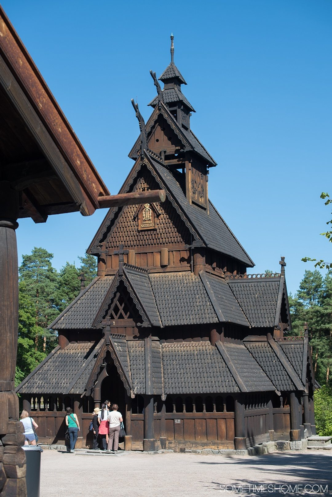 10 Not-to-Miss Sites in Oslo Norway by Sometimes Home travel blog. Photo of a stave church at Norsk Folkemuseum.