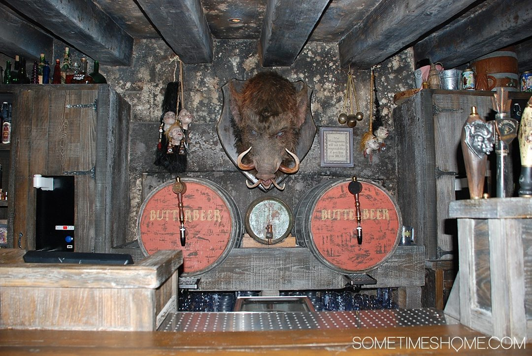 5 Mistakes to Avoid at the Wizarding World of Harry Potter in Orlando, Florida by Sometimes Home travel blog. Photo inside Hog's Head Pub.