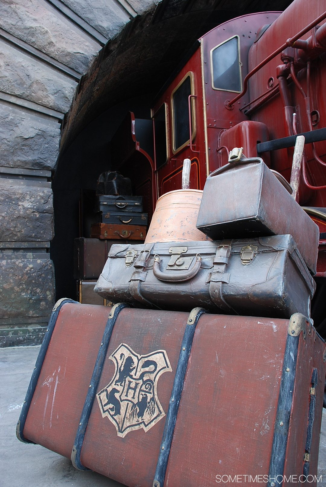 5 Mistakes to Avoid at the Wizarding World of Harry Potter in Orlando, Florida by Sometimes Home travel blog. Photo of Hogwarts Express luggage.