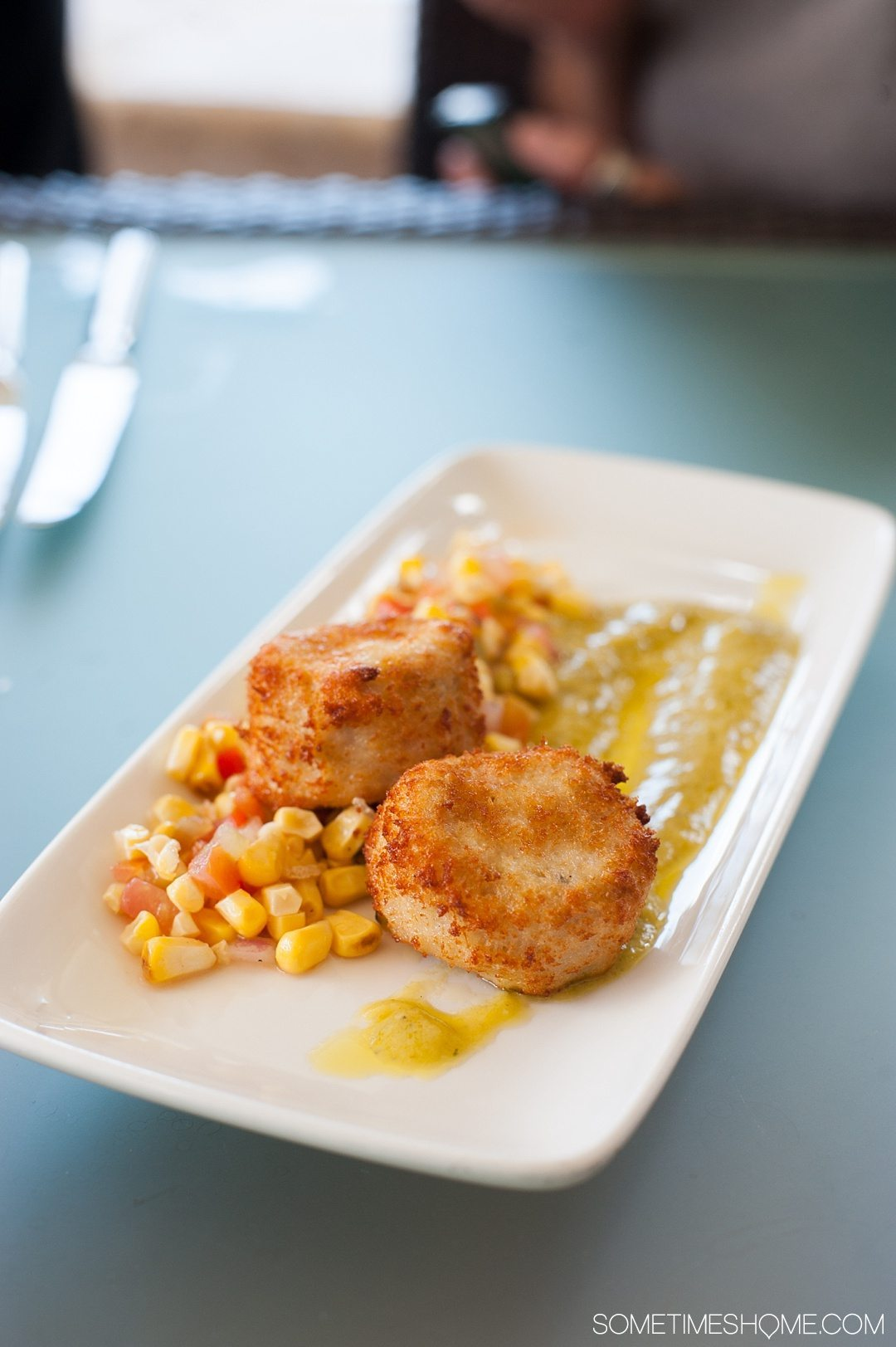 Your Questions Answered: Jade Mountain St. Lucia on Sometimes Home travel blog. Photo of crabcakes and a corn relish at Jade Mountain Club.