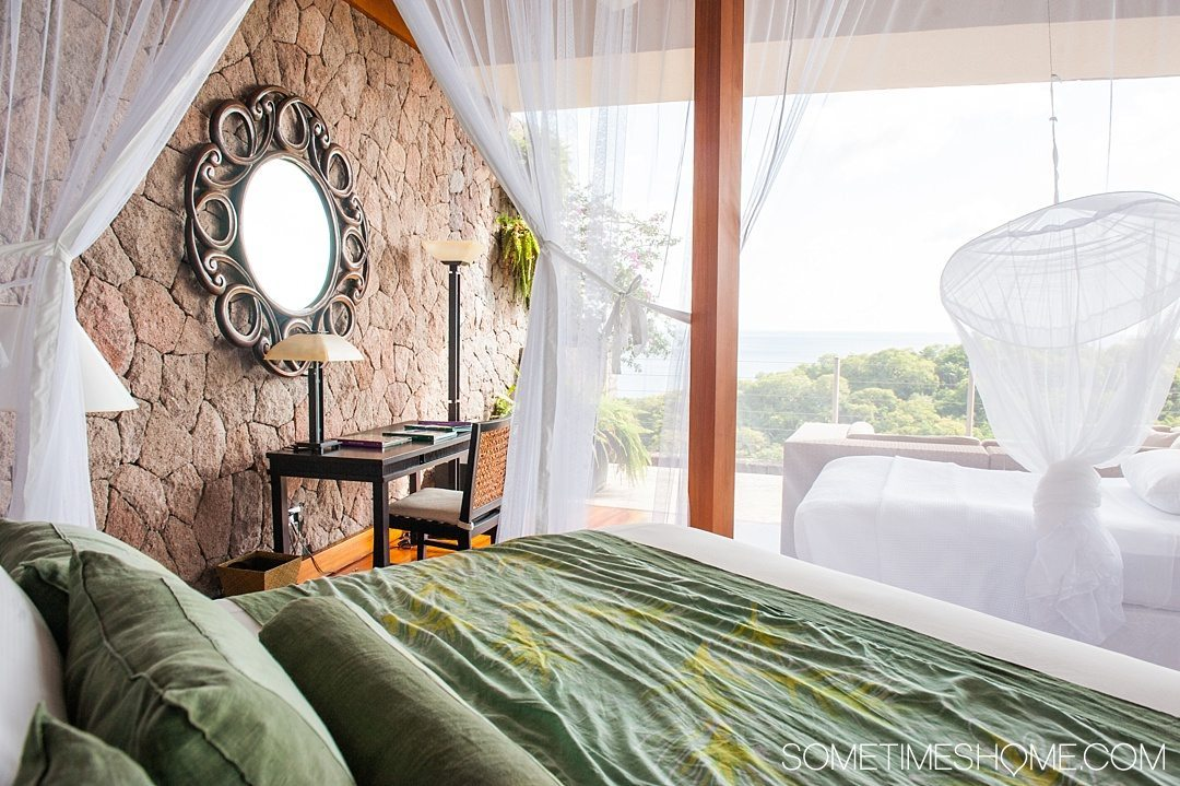 Your Questions Answered: Jade Mountain St. Lucia on Sometimes Home travel blog. Photo of netting around the bed in the Galaxy sanctuary suite.