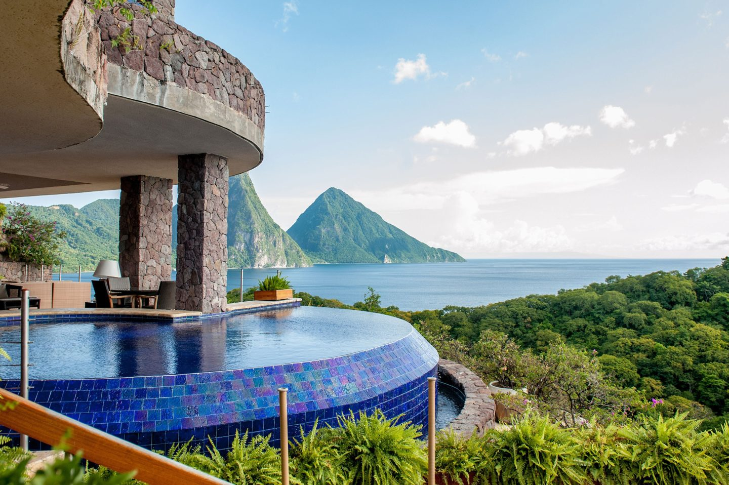 Your Questions Answered: Jade Mountain St. Lucia on Sometimes Home travel blog. Photo of the view of the Pitons and infinity pool from the Galaxy sanctuary suite.