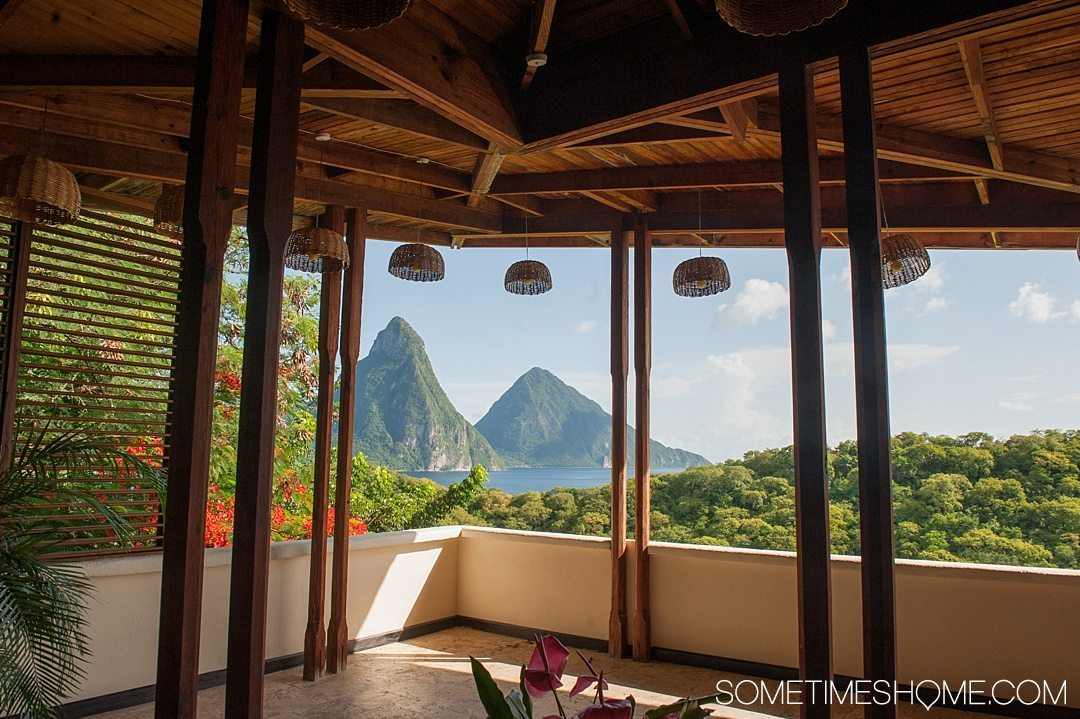 Your Questions Answered: Jade Mountain St. Lucia on Sometimes Home travel blog. Photo of a room at their sister resort Anse Chastanet with a view of the Pitons.